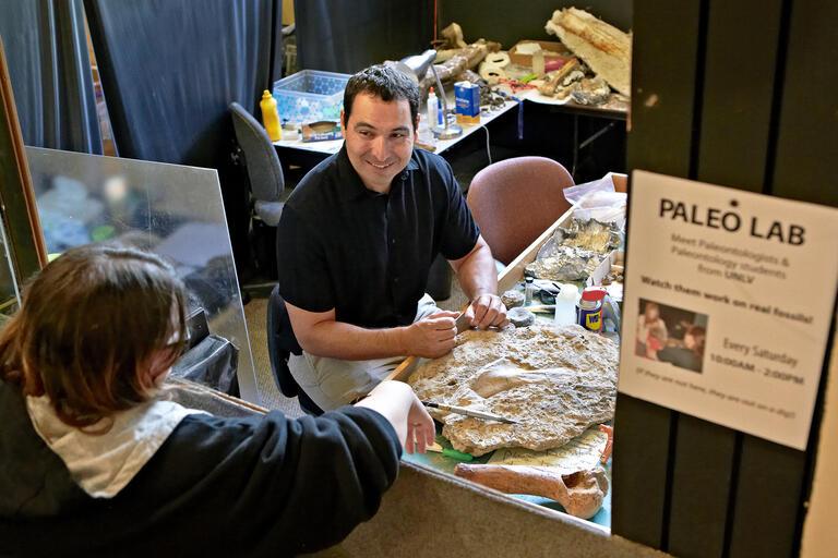 Geoscientist Josh Bonde works in the paleontology lab