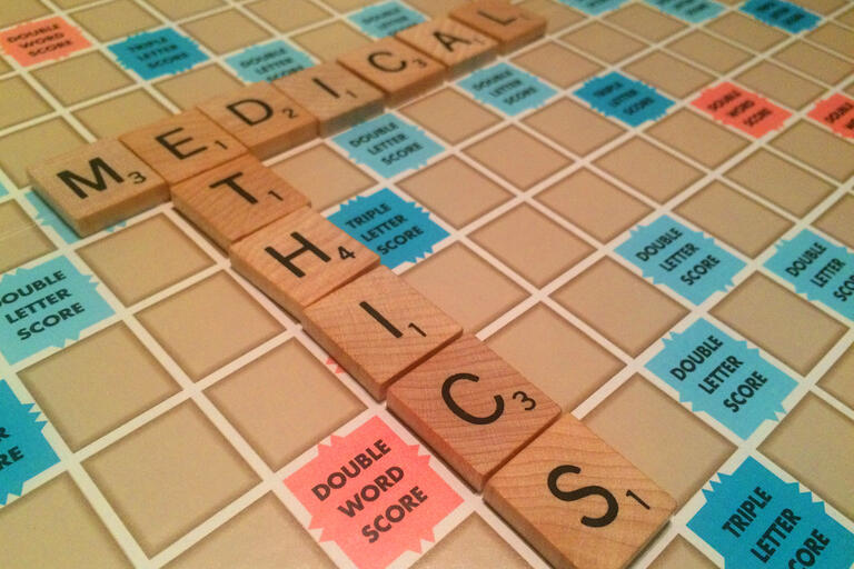 scrabble with the words medical and ethics