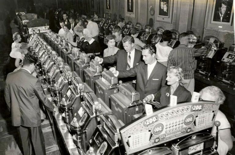 Hotel guests gamble at the slots