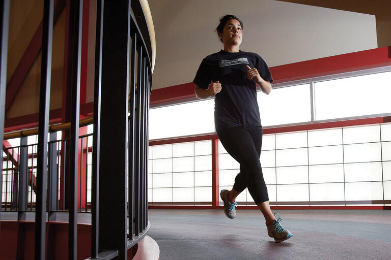 woman jogging on indoor track