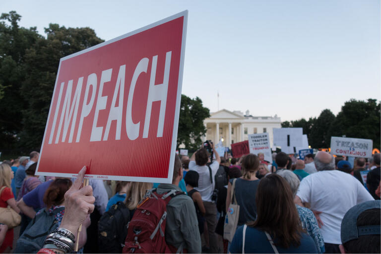 "protesters in front of white house holding ""impeach"" sign"