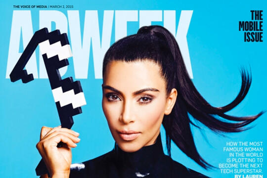 Cover of Ad Week magazine featuring Kim Kardashian holding a pair of pixelated sun glasses
