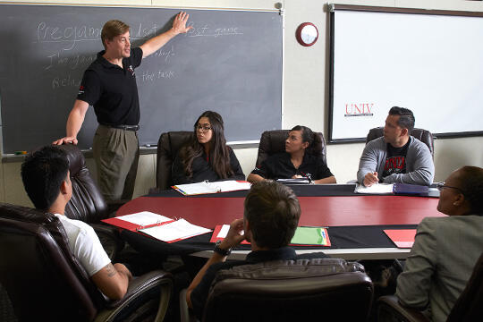 Brad Donohue meets with students