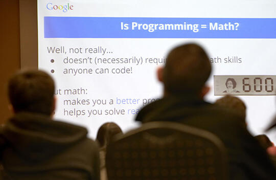Students watch a presentation about programming
