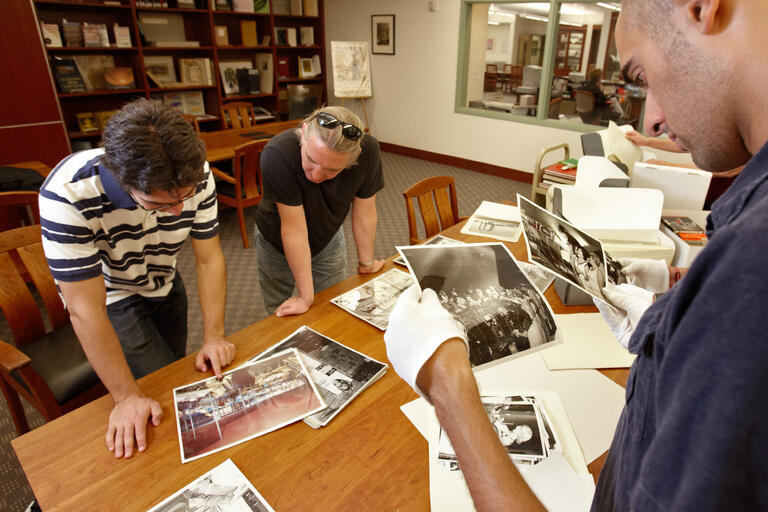 Researchers look through photographs