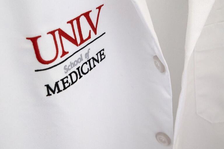 white coat with UNLV School of Medicine logo