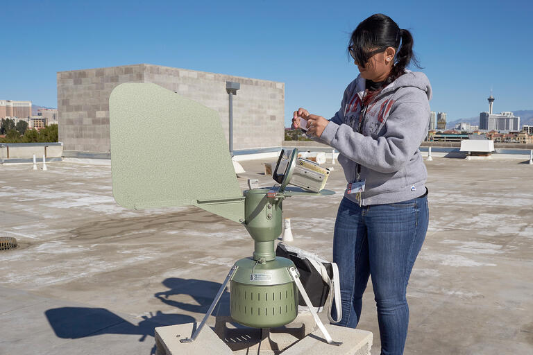 Tanvi Patel collects a pollen sample