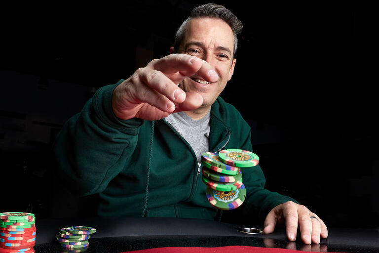 Perry Friedman holds poker chips