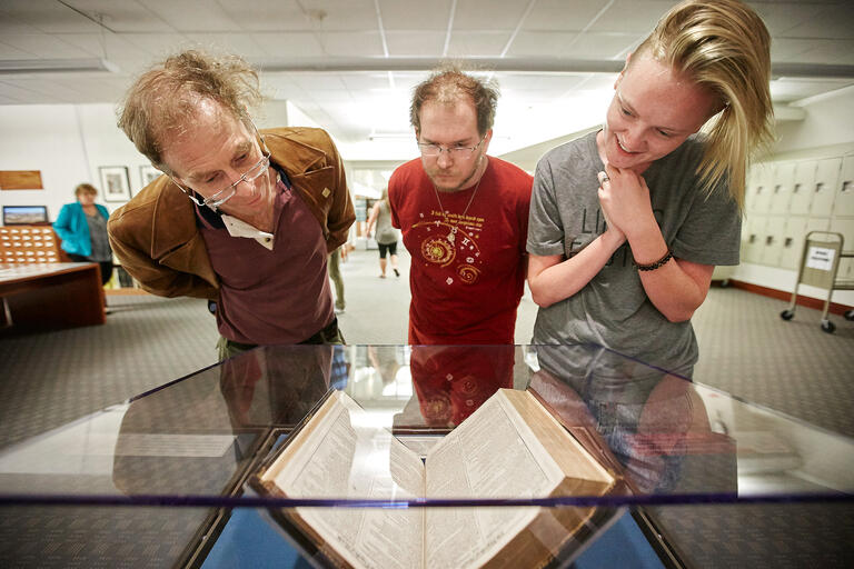 visitors look at Shakespeare's First Folio