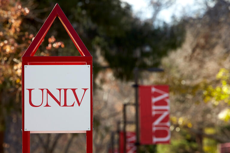Signage with the UNLV logo on campus