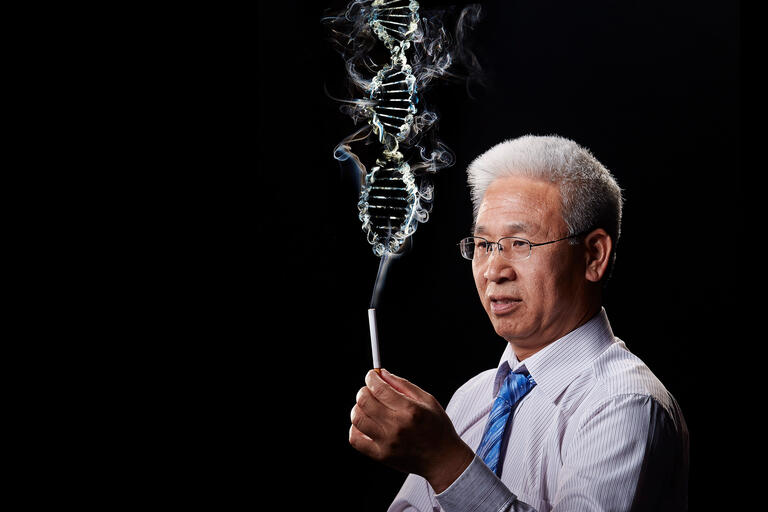 Xiangning Chen holds a cigarette with smoke resembling a DNA strand