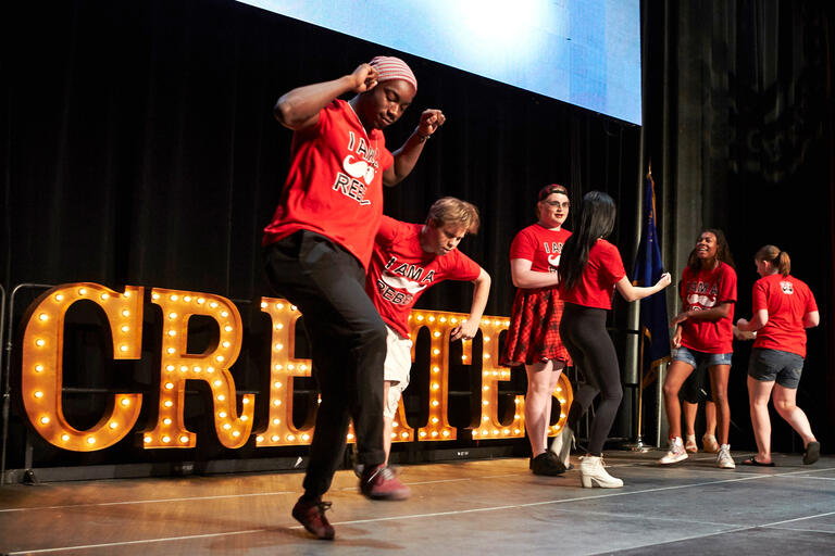 Students peform a dance on stage