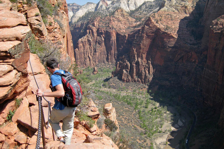 A hiker descends the Angels Landing route in Zion National Park