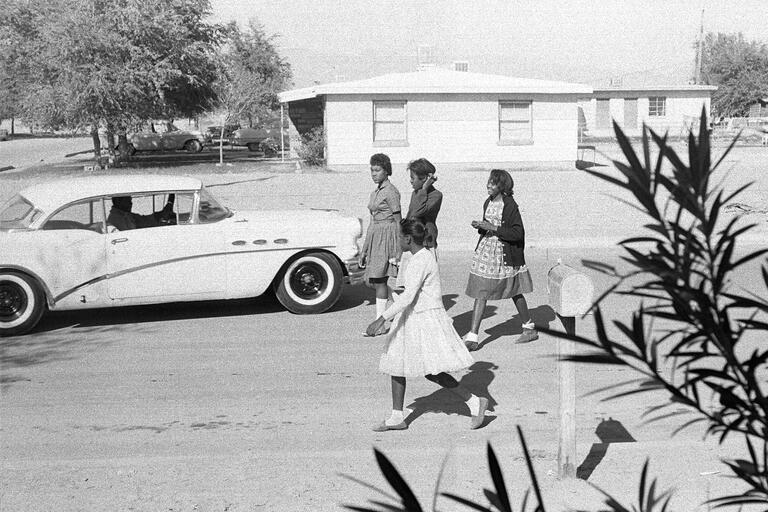 historical image of students walking to school