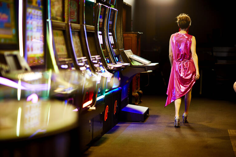 woman walking away from slot machines