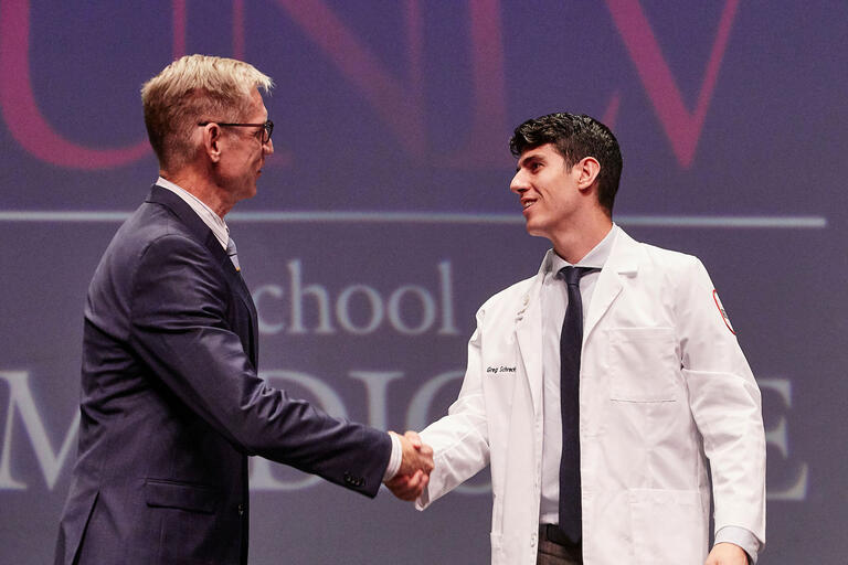 Dr. Stephen Dahlem shakes hands with student Gregory Schreck.