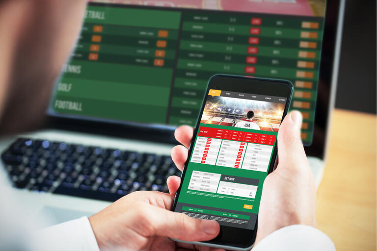 computer screen and smartphone on gambling website