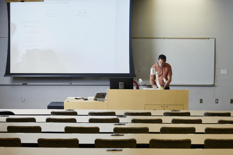professor in empty classroom