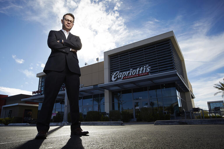 Jason Smylie, standing in front of a Capriotti's