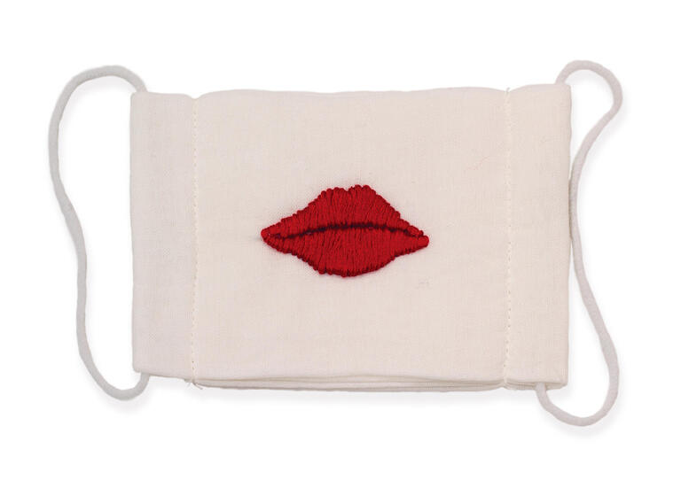 A cloth mask with lips etched into it.