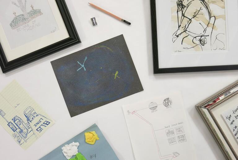 Multiple drawings on a table.