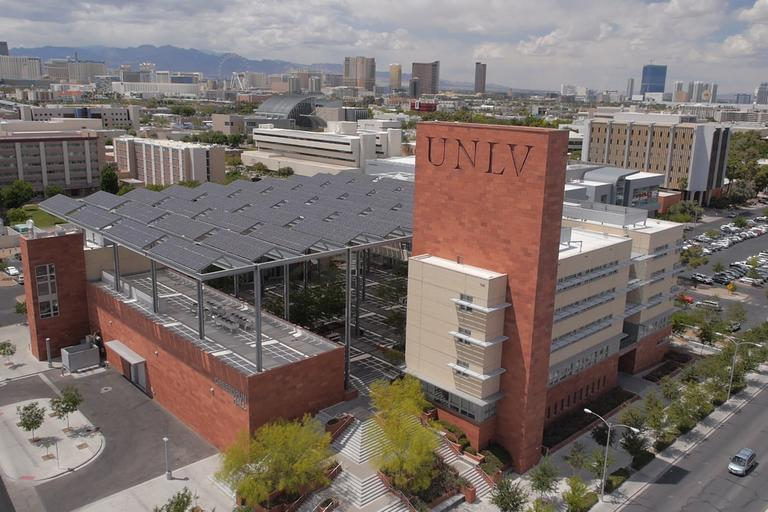 An aerial view of Greenspun Hall and UNLV campus in the background.