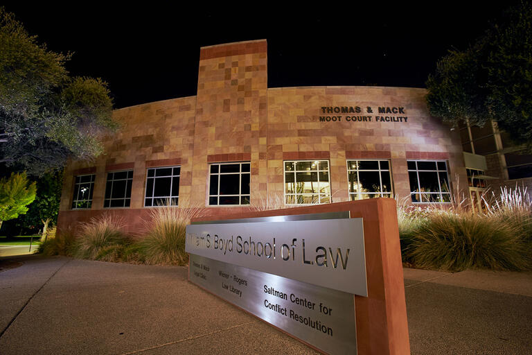 Boyd School of Law building pictured at night.