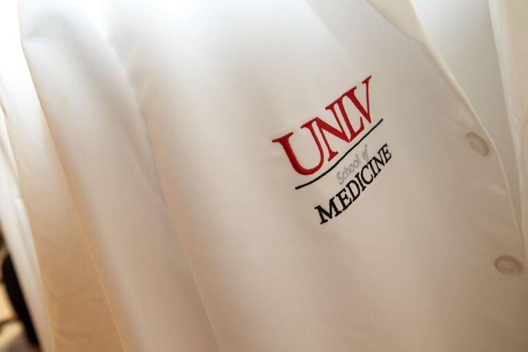 School of medicine white coat with logo
