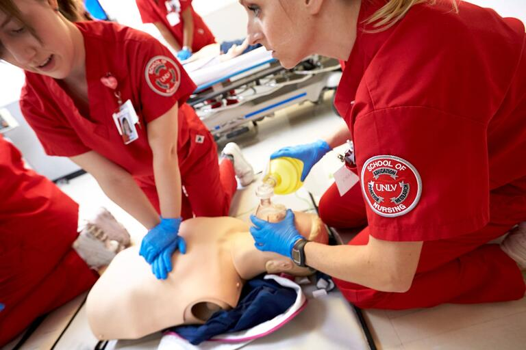 Nursing students practice on a manikin