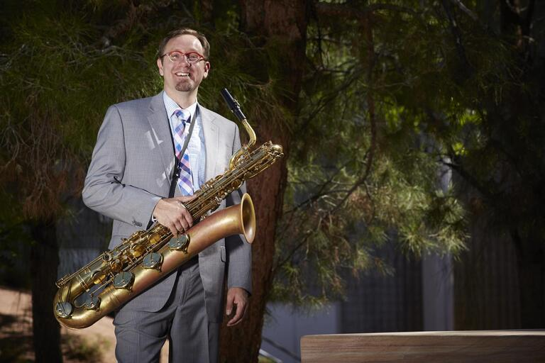 Jazz studies professor Adam Schroeder poses with his saxophone.