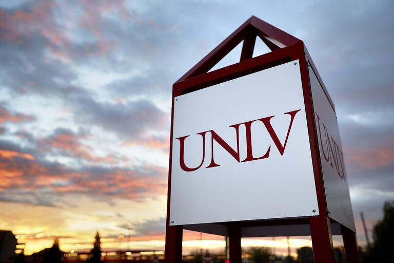 U-N-L-V sign with the sunset in the background.