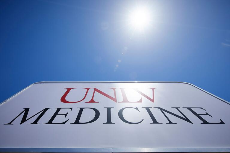 UNLV Medicine sign with blue sky above.
