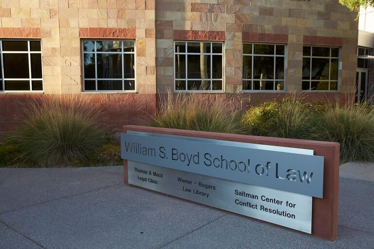 A sign for the William S. Boyd School of Law in front of the building.