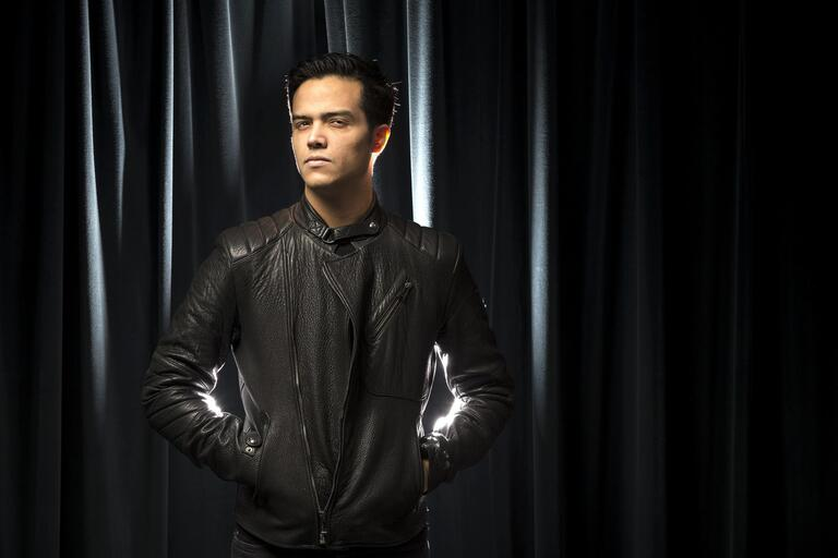 Santiago Michel in a black leather jacket.