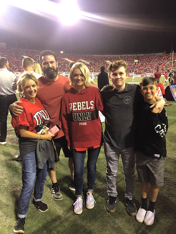Photo of family in a stadium
