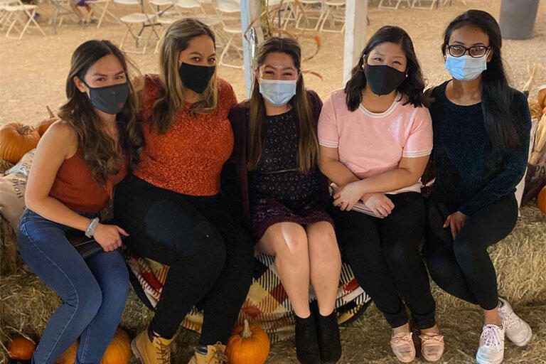 Internal Medicine residents smiling while wearing a mask