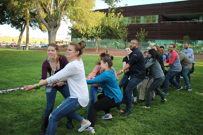 The UNLV School of Medicine Charter Class having a Tug of War competition