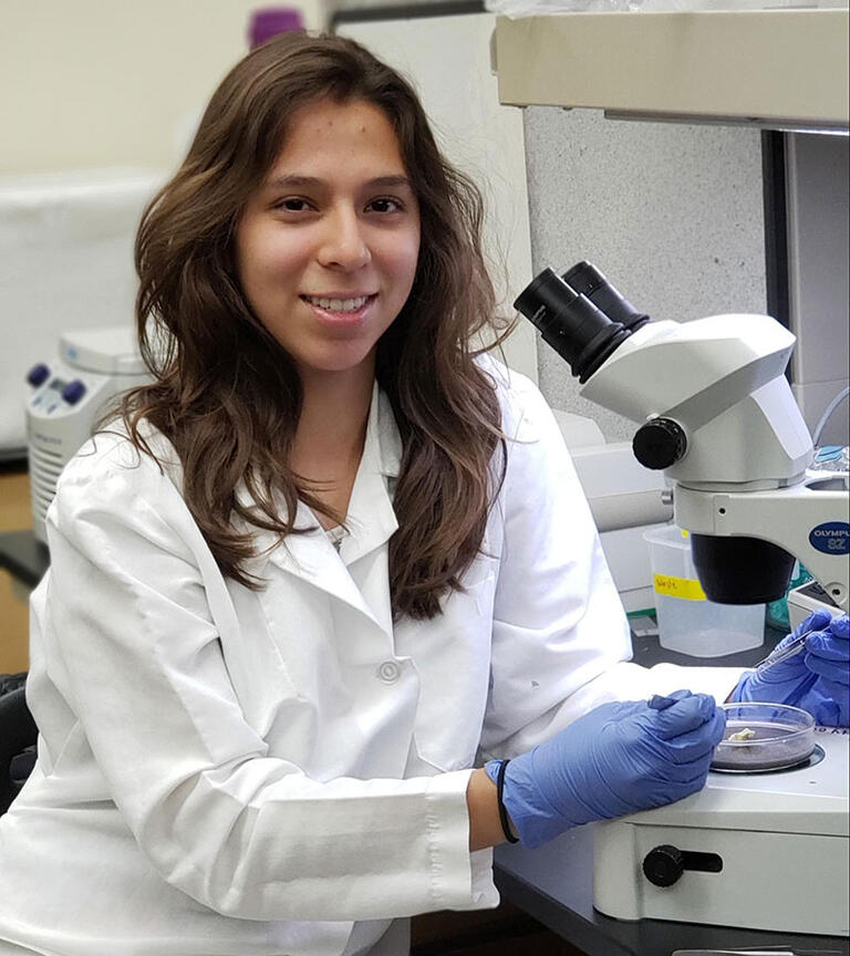 Female student smiling in the lab