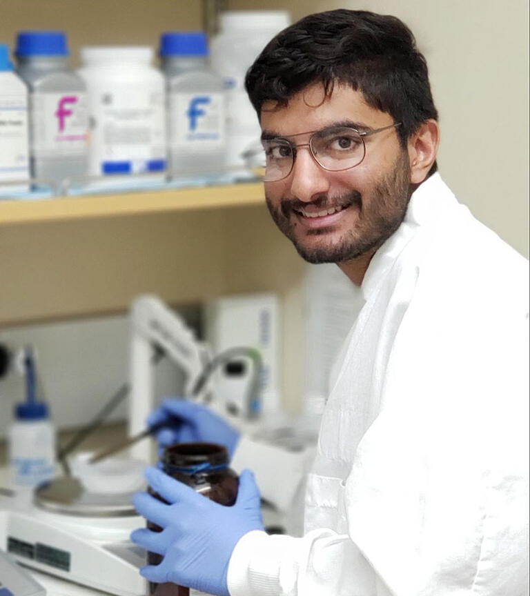 Male student smiling in the lab