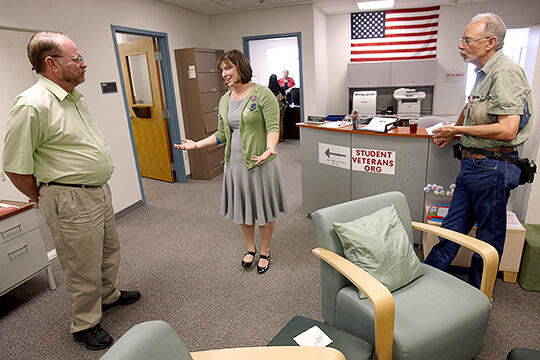 Veterans Services staff assist prospective students.