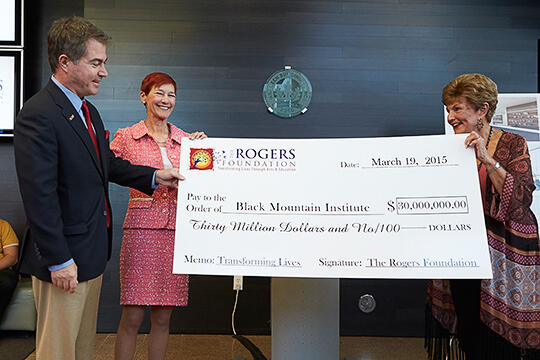 Len Jessup, Beverly Rogers, and President Emerita hold up giant check
