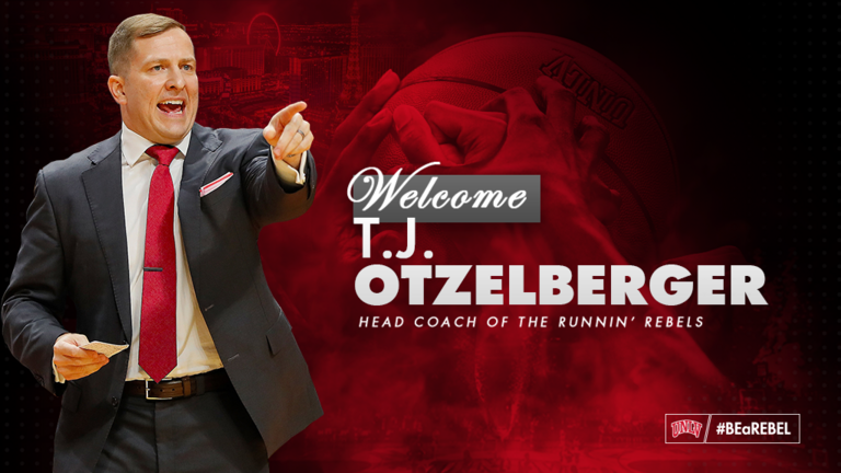 TJ Otzelberger in suit pointing to right. welcome text on graphic