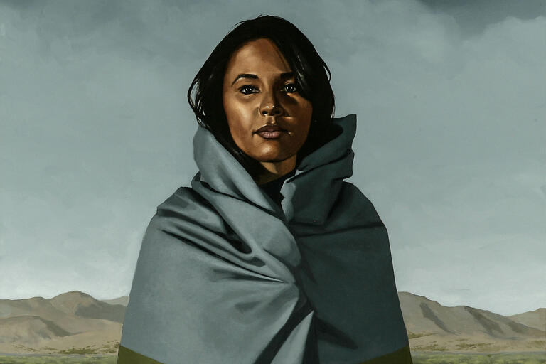 painting of woman in desert wrapped in blanket