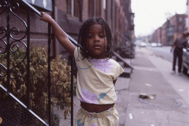 image of young black girl on city street