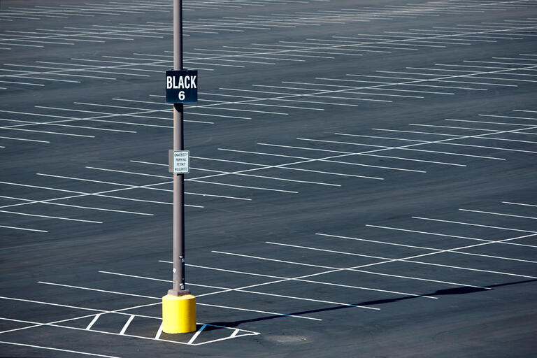 empty parking lot with lot name on sign