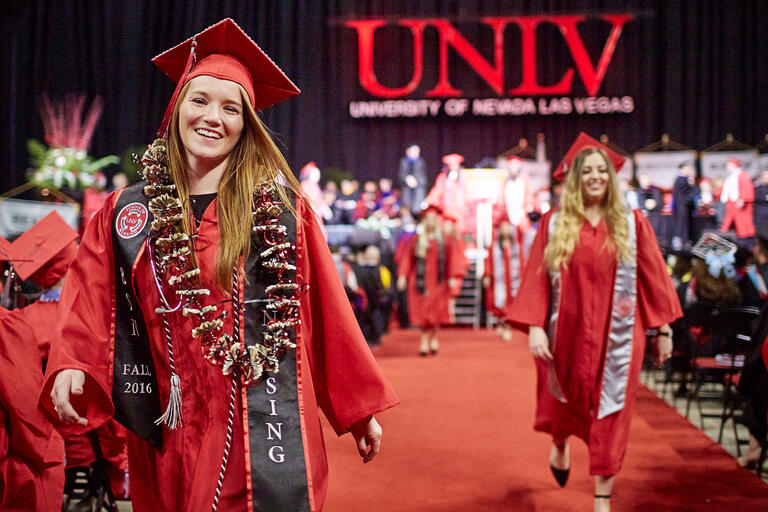 Two female students walking during commencement