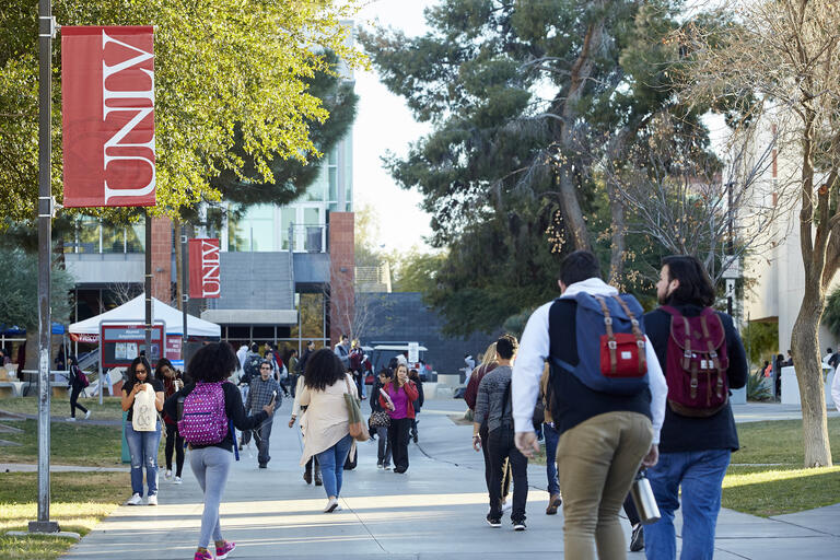UNLV students walking on campus sidewalk