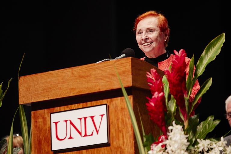 Dr. Barbara Atkinson at podium