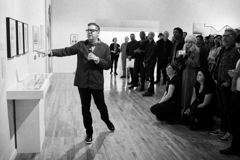 man leading gallery talk