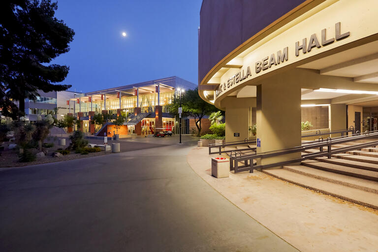 The exterior of Beam Hall and the student union lit up at night